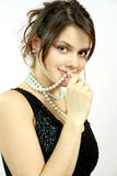 Pretty woman. S portrait with pearls Stock Photo