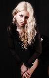 Pretty woman. Studio portrait of blonde girl against black background Royalty Free Stock Image