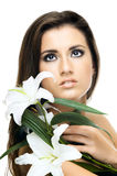 Pretty woman. The very  pretty woman on white background, with lily, sensual sexuality gaze Stock Photography