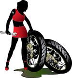 Pretty woman. With wrench and wheels Royalty Free Stock Image