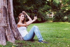 Pretty woman with action camera in her hand. Stock Images