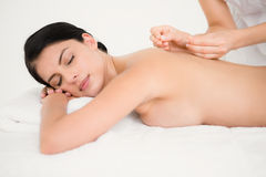 Pretty woman in an acupuncture therapy Stock Images