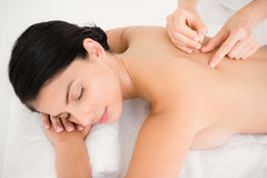 Pretty woman in an acupuncture therapy Stock Photography