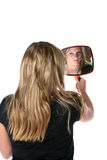 Pretty woman admiring reflection in hand mirror Stock Photo