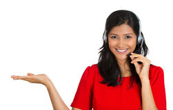 Pretty woman adveritising. Closeup portrait of beautiful, adorable smiling female customer representative with phone headset pointing at copy space isolated on Royalty Free Stock Images