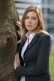 Pretty woman against tree Stock Images