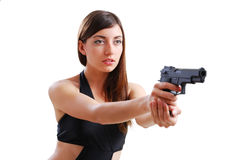 Pretty woman aiming a pistol. Royalty Free Stock Photo