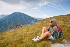 Pretty woman in an alpine landscape Royalty Free Stock Image