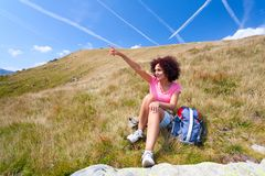 Pretty woman in an alpine landscape Stock Photo