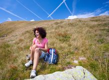 Pretty woman in an alpine landscape Stock Photography