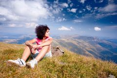 Pretty woman in an alpine landscape Stock Photos
