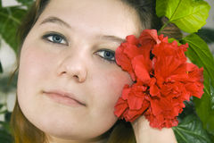Pretty Woman And Red Hibiscus Stock Photography