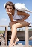 Pretty woman with angel wings Royalty Free Stock Photos