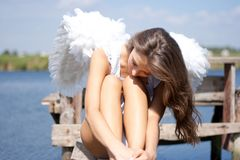 Pretty woman with angel wings Stock Photography