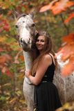 Pretty woman with appaloosa horse in autumn Royalty Free Stock Photos