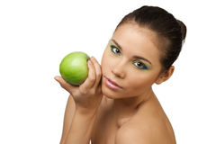 Pretty woman with apple Royalty Free Stock Photography