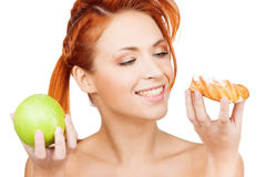 Pretty woman with apple and cake Royalty Free Stock Image
