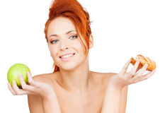 Pretty woman with apple and cake Royalty Free Stock Photos