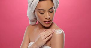 Pretty Woman Applying Cosmetic Cream Stock Images