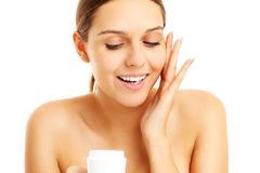 Pretty woman applying cream on face Royalty Free Stock Photos