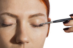 Pretty Woman Applying Eye Shadow Makeup Royalty Free Stock Images