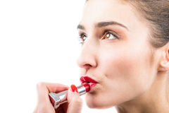 Pretty woman applying lip gloss make up Royalty Free Stock Images