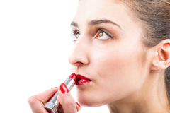 Pretty woman applying lip gloss make up Royalty Free Stock Photos