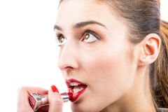 Pretty woman applying lip gloss make up Stock Photo