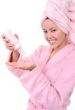 Pretty Woman Applying Lotion Royalty Free Stock Image
