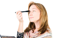 Pretty woman applying make up. Royalty Free Stock Images
