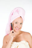 Pretty woman applying make up Royalty Free Stock Photos
