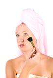 Pretty woman applying make up Stock Photo