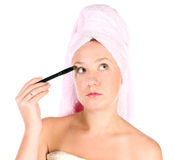 Pretty woman applying make up Royalty Free Stock Photo