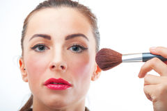 Pretty woman applying make up Royalty Free Stock Image