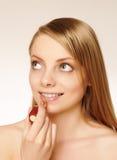 Pretty woman applying make up. Royalty Free Stock Photos