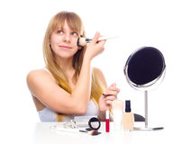 Pretty woman applying make up with brush Royalty Free Stock Image