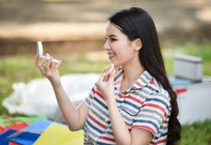 Pretty woman applying make-up with powder. At out Royalty Free Stock Images