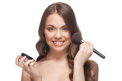 Pretty woman applying makeup Stock Photography