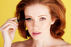 Pretty Woman Applying Mascara Royalty Free Stock Photo