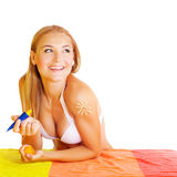 Pretty woman applying suncream Royalty Free Stock Photography