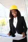 Pretty Woman Architect. A young pretty woman working as architect on a construction site Royalty Free Stock Image