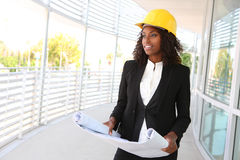 Pretty Woman Architect. A young pretty woman working as architect on a construction site Royalty Free Stock Images