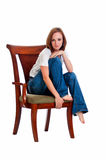 Pretty woman in an arm chair. Stock Images