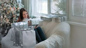 Pretty woman astonished with the surprise inside of the box.  stock video