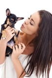 Pretty Woman Attempts to Kiss her Puppy Stock Image