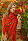 Pretty woman with autumn leaves. Outdoors royalty free stock images
