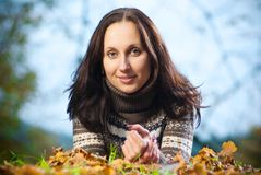 Pretty woman on autumn meadow Royalty Free Stock Image