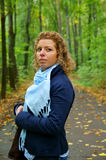 Pretty woman in autumn park Stock Images