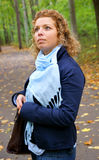 Pretty woman in autumn park Stock Image