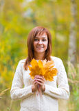 Pretty woman in an autumn park Stock Photography